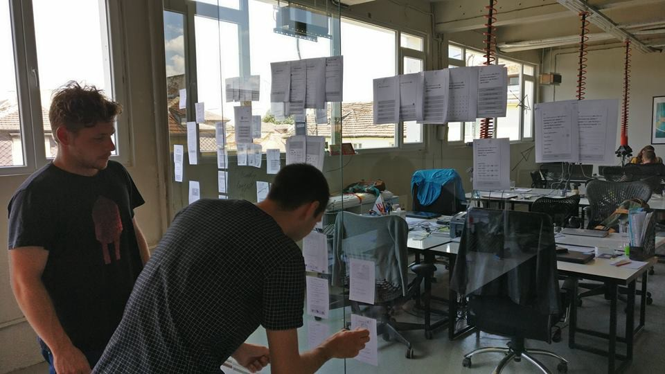 mapping using notes stuck on window at the Despark office