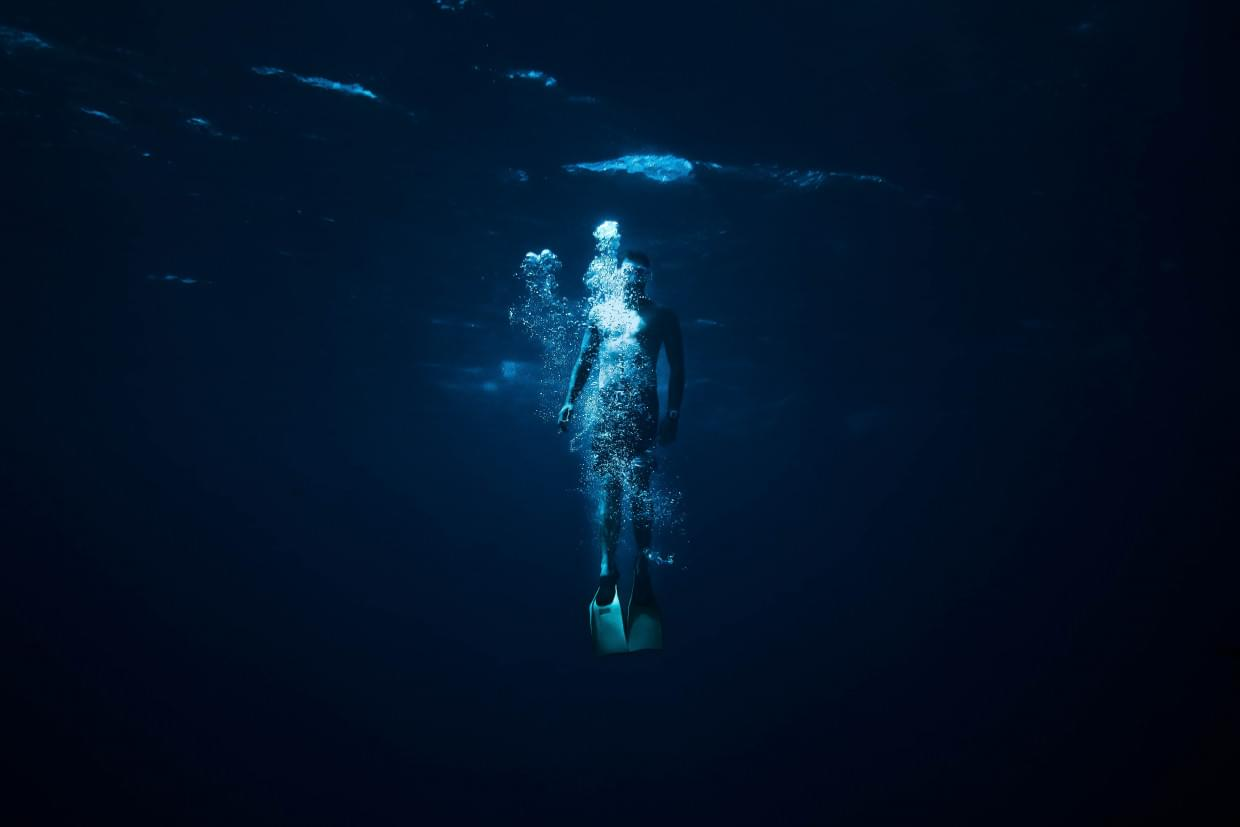 Mental health: person underwater in blue light